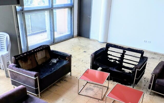 Burnt chairs at the Neve Shalom library