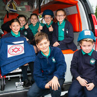 Students with the MDA ambulance at Clore Shalom (Credit: Yakir Zur)