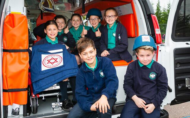Students with the MDA ambulance at Clore Shalom (Credit: Yakir Zur)