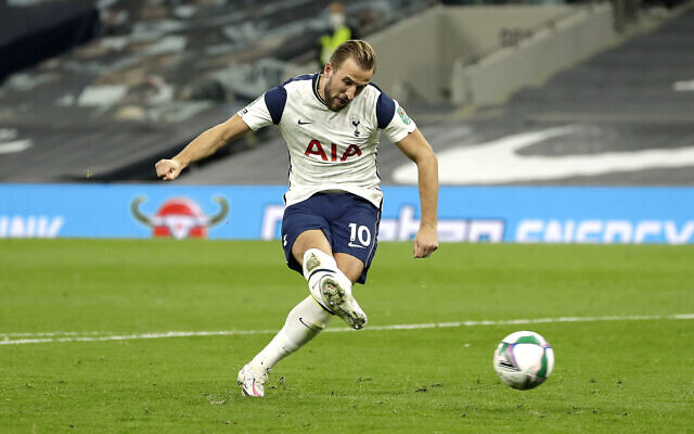 Tottenham Hotspur's Harry Kane scores his side's fifth goal of the penalty shoot-out during the Carabao Cup fourth round match at the Tottenham Hotspur Stadium, London.
