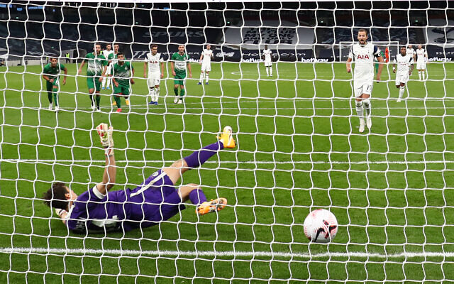 Tottenham Hotspur's Harry Kane scores his side's fifth goal of the game from a penalty during the UEFA Europa League playoff match at the Tottenham Hotspur Stadium, London.
