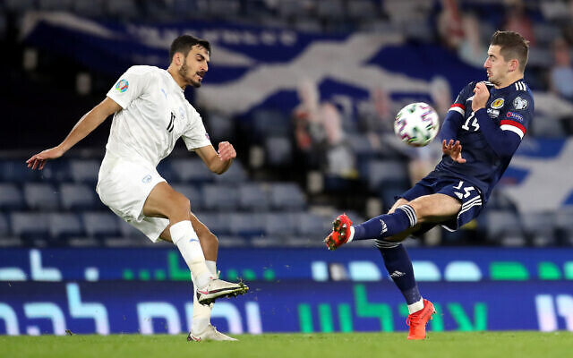 Israel's Manor Solomon kicks the ball towards Scotland's Kenneth McClean during the UEFA Euro 2020 Play-Off semi final match at Hampden Park, Glasgow. (PA Wire/PA Images)