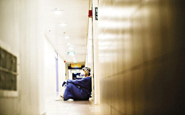 An exhausted staff member at Haifa's Bnai Zion Medical Center