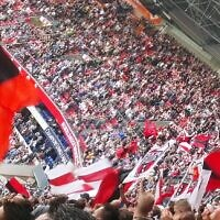 Ajax supporters in the stadium (Wikipedia/Author	Onderwijsgek/Attribution-ShareAlike 3.0 Unported (CC BY-SA 3.0)  https://creativecommons.org/licenses/by-sa/3.0/legalcode)