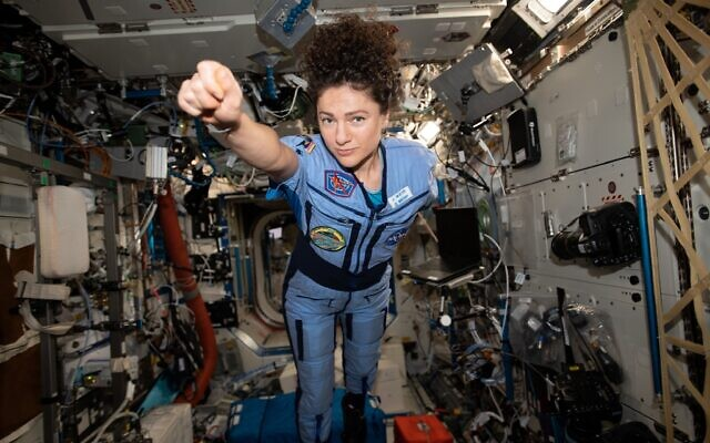 Jessica Meir strikes a superhero pose while on board the International Space Station. Credit: NASA
