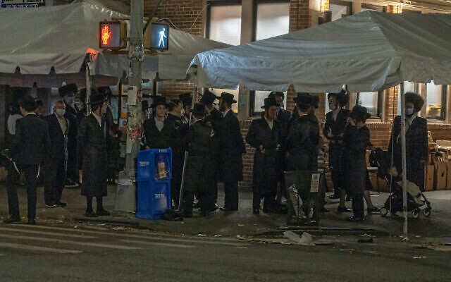 Orthodox Jewish men gather on the Jewish holiday of Simchat Torah at the Borough Park neighborhood of Brooklyn.  (Photo by Ron Adar / SOPA Images/Sipa USA)