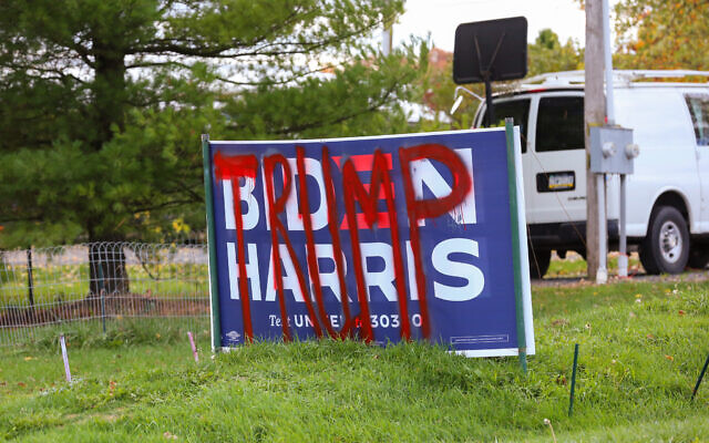 "A defaced Biden-Harris sign is spray-painted with the word ""Trump"" near Centre Hall, Pennsylvania on October 24, 2020. (Photo by Paul Weaver/Sipa USA)"