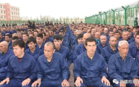 Uyghur men held in camps in north-west China. Estimates suggest more then one million Muslims are being held in such conditions.