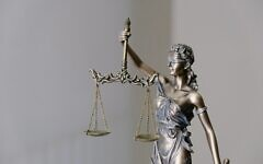 Lady Justice (Photo by Tingey Injury Law Firm on Unsplash)