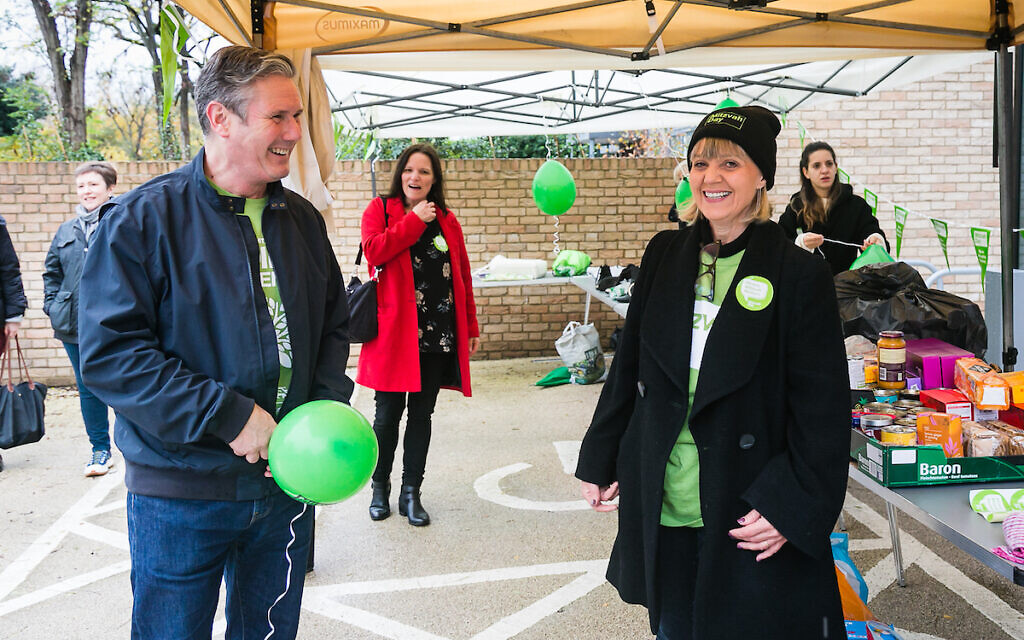 Keir Starmer at South Hampstead Synagogue with Mitzvah Day sounder Laura Marks, sorting through items which will be donated to charity. (Credit: Yakir Zur)
