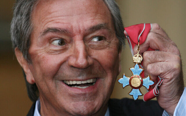 Veteran entertainer Des O'Connor with his CBE at Buckingham Palace