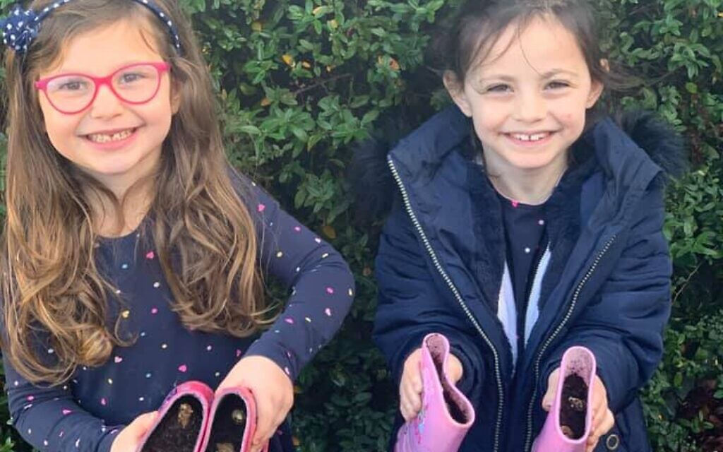 Younger members of Stanmore, Liora and Aviva Turgel planting bulbs in their wellies
