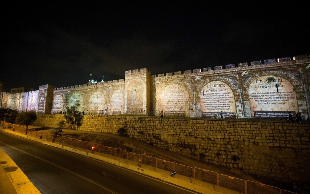 Messages projected on Jerusalem's old city walls.