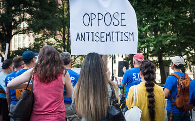 Protesters with a sign opposing antisemitism  (Photo by Gabriele Holtermann-Gorden/Sipa)