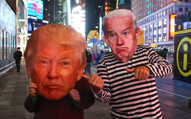 Atmosphere of people with big face mask of Donald Trump and Joe Bidden during The Presidential Election night in Times Square, New York CITY, NY, USA on November 3, 2020. Photo by Charles Guerin/ABACAPRESS.COM
