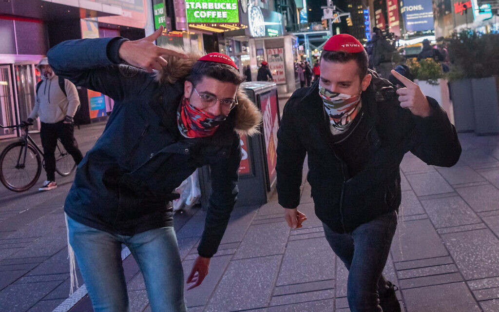 Two Trump supporters join a small group of New Yorkers that gathered in Times Square in New York City on election night on November 3, 2020. (Photo by Gabriele Holtermann/Sipa USA)