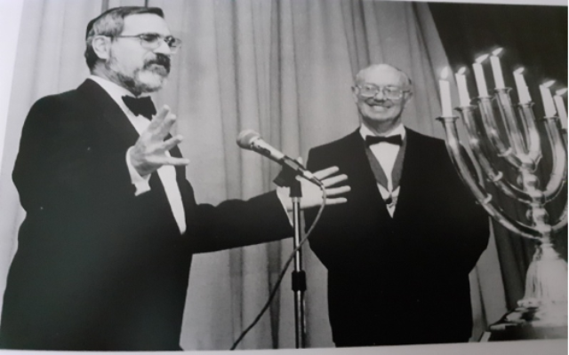 Induction of  Rabbi  Sacks to membership of the Lodge with Gerald Kirsh President of First Lodge at the time.