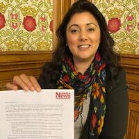 Nus Ghani holding the Uyghur petition