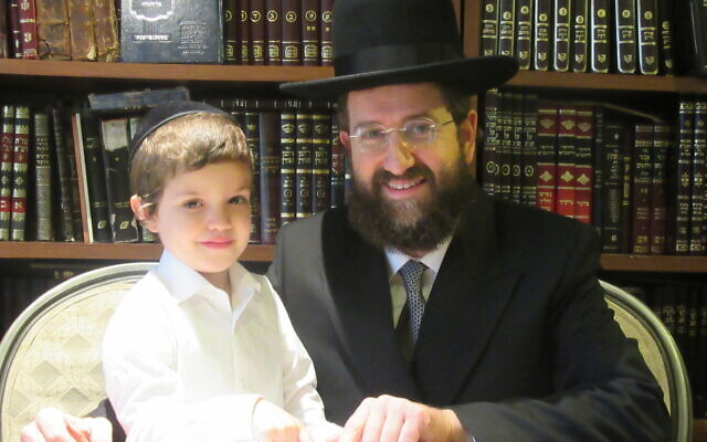 Dayan Dovid Engalnder with his 4-and-a-half year-old son, Shimon