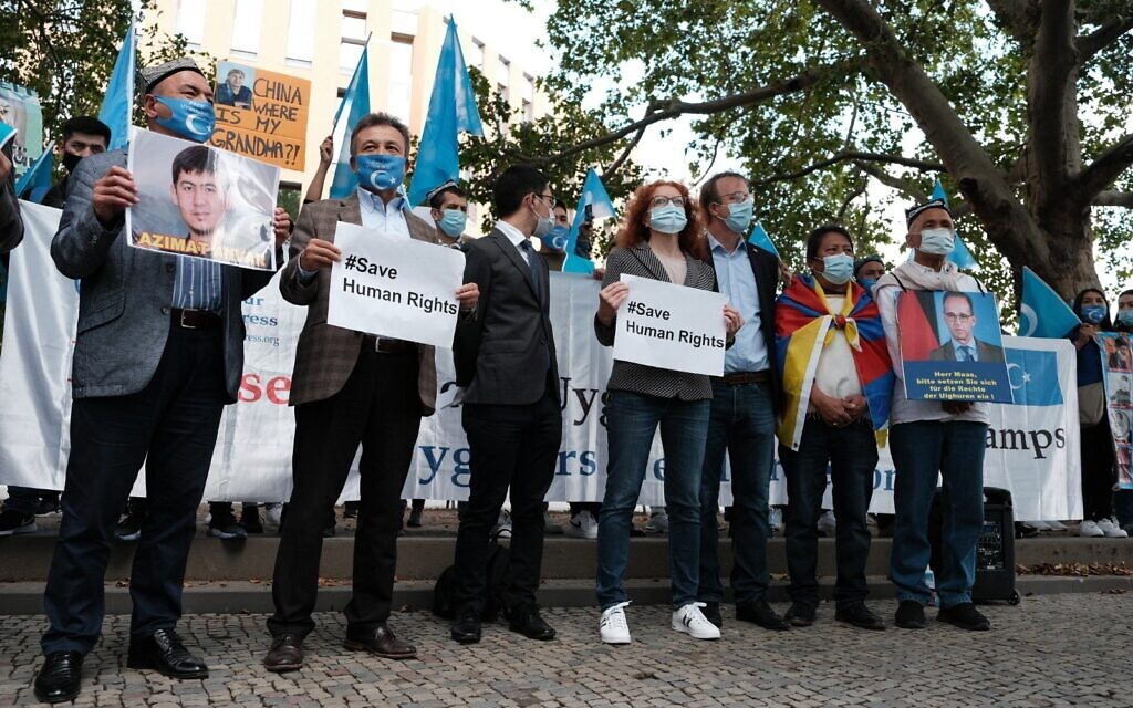 Activists standing in solidarity with Uyghur Muslims (Credit: Ilan Selby and Johan Kaye)