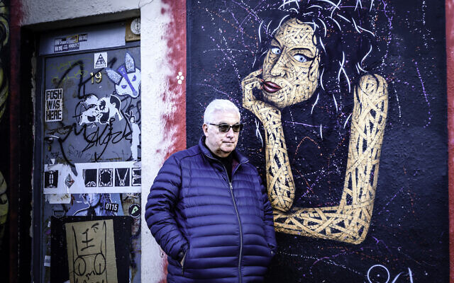 Mitch Winehouse next to a mural of Amy