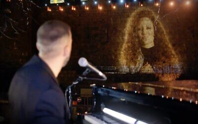 "Musicians Idan Raichel and Jess Glynne projected on the ancient walls of Jerusalem's Old City, as they perform during ""Illuminate: A Global Jewish Unity Event,"" to celebrate the Declaration of Our Common Destiny and Israeli President Reuven Rivlin's endorsement."