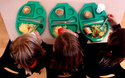 Picture of pupils enjoying school dinners at a Primary School.