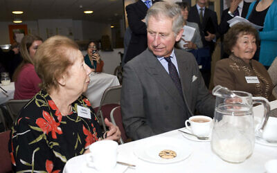 The Prince of Wales (centre) speaks with Bertha Leverton and Bertha Ohayon, at the Kinder Transport Reunion at the Jewish Free School, Kingsbury, London.