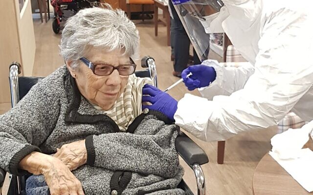 Marion Phillips, 95, receives her vaccination at Jewish Care's Anita-Dorfman house
