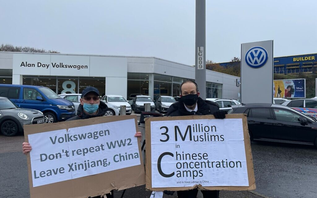 A demonstrator outside Volkswagen showroom, Southgate, London, protesting the company's presence in the Uyghur region of China and its use of Uyghur forced labour.