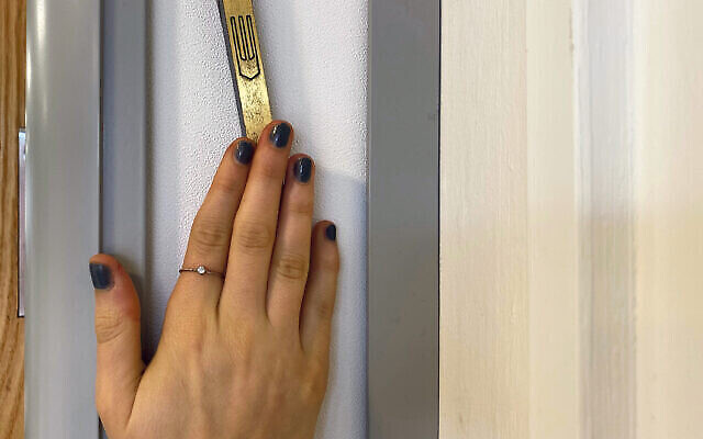 Hand on a Mezuzah