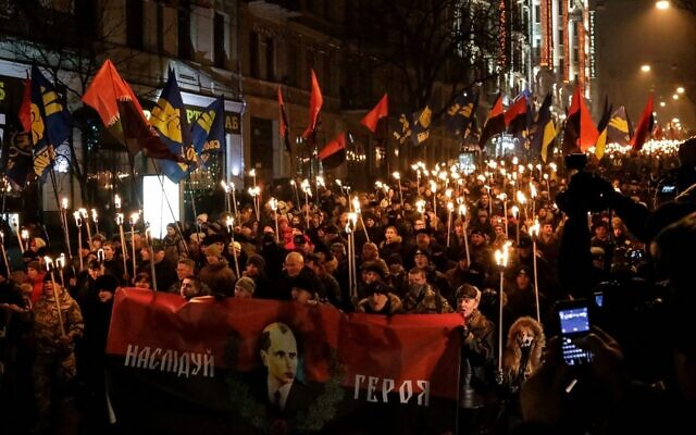 Ukrainian nationalists march through Kyiv, 1 January 2015   (Wikipedia / Source	https://picasaweb.google.com/102652274152528116947/1012015#6099508032725263714 Author	ВО Свобода / Attribution 3.0 Unported (CC BY 3.0)   )