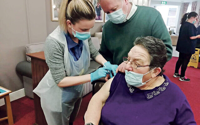 Jewish Care resident Eveline Baer getting a jab this week