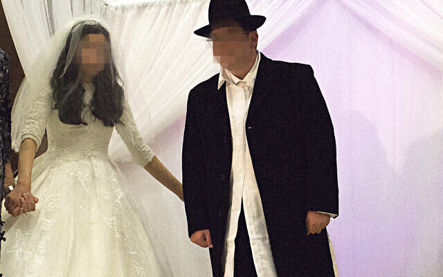 A strictly-Orthodox couple at a pre-lockdown wedding