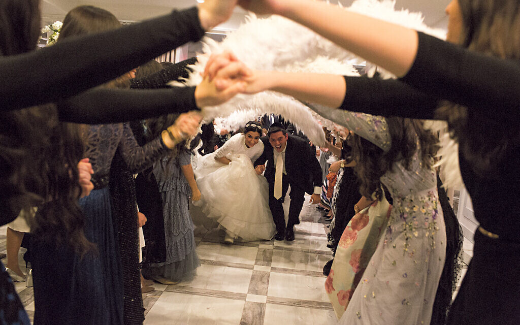 This wedding took place before the pandemic but similar weddings are being held every day among some strictly-Orthodox communities