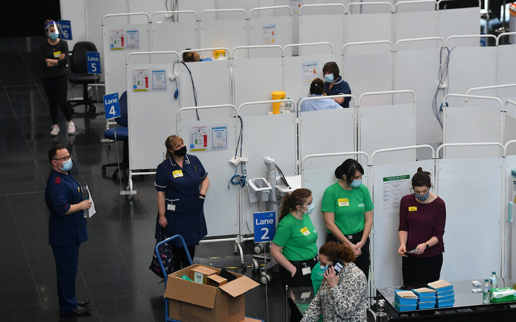 Members of staff prepare to administer injections of a Covid-19 vaccine at the NHS vaccine centre that has been set up at the Millennium Point centre in Birmingham.