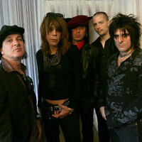 The New York Dolls (left to right Sylvain Sylvain, David Johansen, Sami Yaffa, Brian Delaney and Steve Conte) in the dressing room at KoKo in Camden, north London. Slash and Billy Idol have led tributes to guitarist Sylvain Sylvain after he died of cancer at the age of 69.