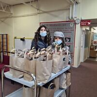 Amanda Barbanel and Jacqueline Harris with their food packages