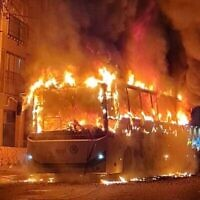 A bus set alight by a mob in the city of Bnei Brak, January 24, 2021. (Israel Police via Times of Israel)