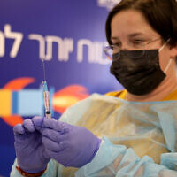 A medical worker prepares a vaccine against the COVID-19 at a municipality vaccine center in Tel Aviv, Israel, Dec. 31, 2020. (Gideon Markowicz/JINI via Xinhua)