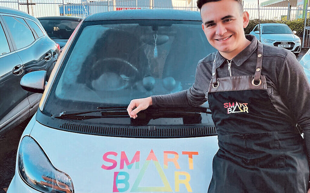Ben Morrison with his Smart car, the back of which he has converted into a coffee bar