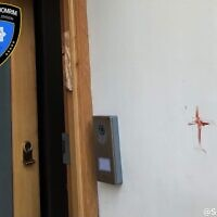 Red cross daubed on a Jewish home. (Credit: Shomrim)