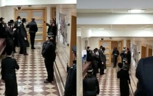 Screenshot from Jewish News' video last week, in which police were filmed intervening at a Charedi wedding. Rabbi Yossi Teitelbaum is believed to be pictured top right with his hands outstretched.