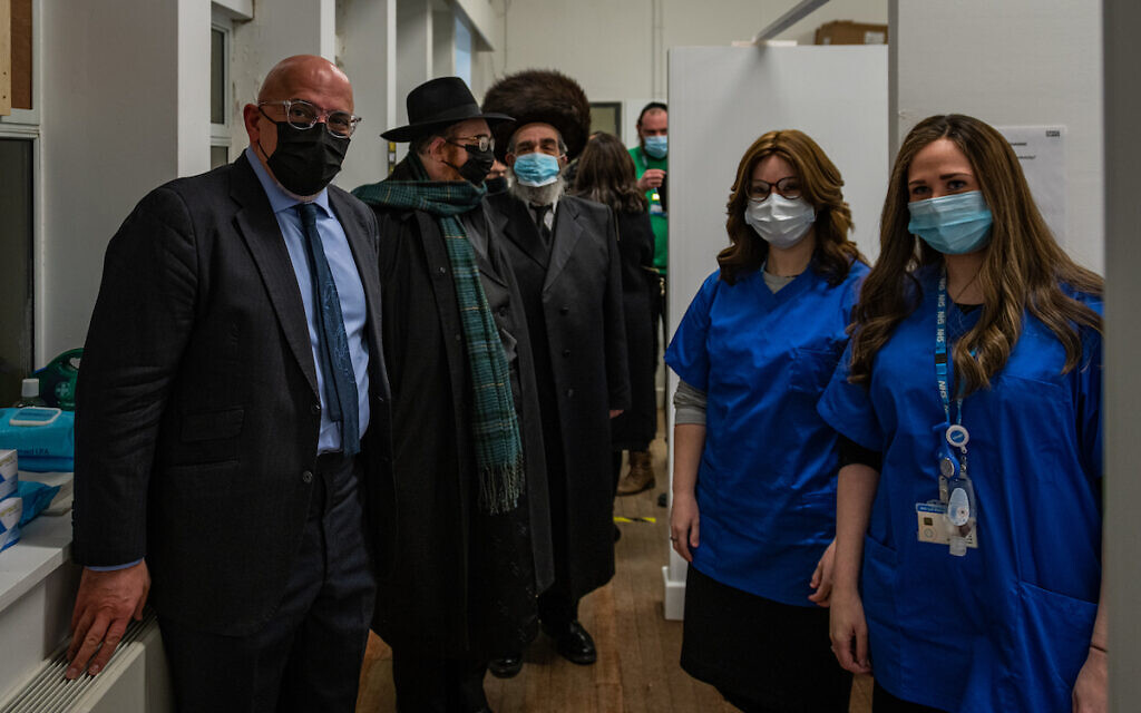 Vaccination volunteers with Nadhim Zahawi, Parliamentary Under-Secretary of State for COVID-19 Vaccine Deployment since 2020