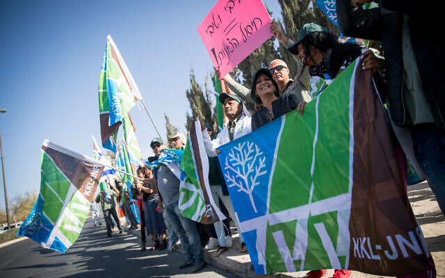 KKL-JNF Workers holding signs and flags during a protest outside the Prime Minister's Office in Jerusalem,