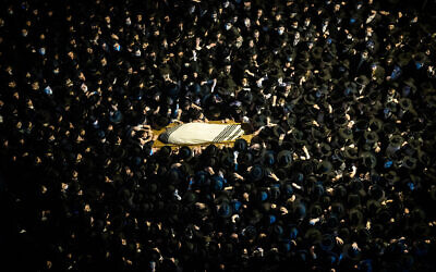 Men carry the body of Rabbi Yitzchok Sheiner who died from Covid-19, during his funeral in Jerusalem. Police didn't stop this superspreader event to avoid 'bloodshed'.