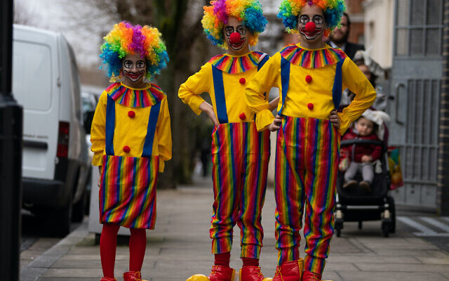 Orthodox Jewish children dressed as clowns celebrate the festival of Purim in Stamford Hill in north London.