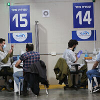 People wait to receive COVID-19 vaccines in central Israeli city of Givatayim, Jan. 19, 2021. According to the Ministry, the number of people vaccinated against the COVID-19 in Israel has reached 2,216,000, or 23.8 percent of its population of 9.3 million, since the vaccination campaign began on Dec. 20, 2020. (Photo by Muammar Awad/Xinhua)