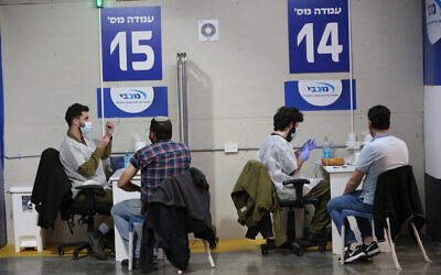 People wait to receive COVID-19 vaccines in central Israeli city of Givatayim,   (Photo by Muammar Awad/Xinhua)