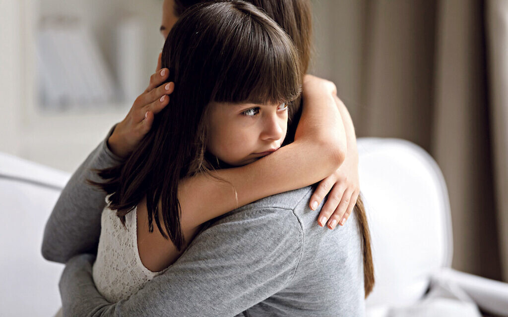 Close up view of upset little daughter cuddling mother, child receiving protection and support from mommy, adopted kid girl and new parent, sole custody, offspring and motherhood connection concept